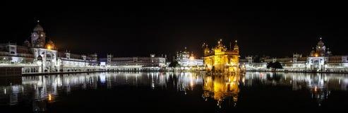 Panoramic view of Sri Harmandir Sahib at night, Golden Temple, Amritsar, Punjab, India. Sri Harmandir Sahib `The abode of God`, also known as Darbar Sahib Royalty Free Stock Photo