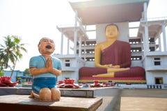 Sri Lanka, ancient buddha statues in a temple Stock Photo