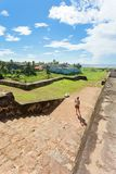 Sri Lanka, Galle - A woman visiting the medieval town wall of Ga Royalty Free Stock Photos