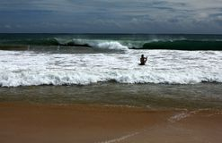 Sri Lanka - body surfing at Mirissa beach stock image