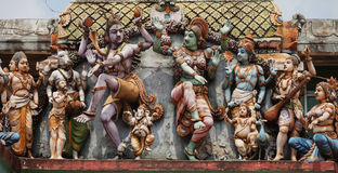 Decoration on the Hindu temple wall. Figures of dancing people Royalty Free Stock Images