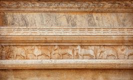 Sri Lanka. Elephants, horses, lions and buffaloes on temple wall stock photo