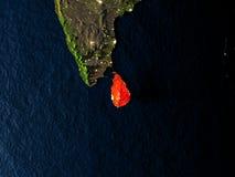 Sri Lanka en rouge de l'espace la nuit Images stock