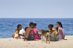 Sri Lanka family sitting on the beach, at Batticaloa, Sri lanka Royalty Free Stock Image