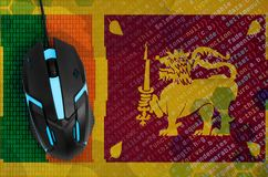 Sri Lanka flag and computer mouse. Digital threat, illegal actions on the Internet royalty free stock photography