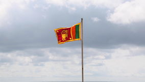Sri Lanka flag flapping in the wind. Developing the flag of Sri Lanka against the sky stock video