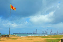 Sri Lanka Flag and the Harbor. At Colombo royalty free stock image
