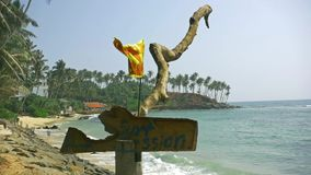 Sri Lanka Flag wooden sign with surf school beach background stock video footage