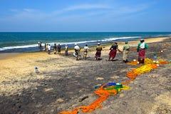 Sri Lanka, November 14: Indian Ocean fishermen pull the net with Royalty Free Stock Images