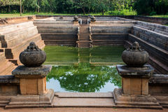 Sri Lanka is the pair of pools known as Kuttam Pokuna. One of the best specimen of bathing tanks or pools in ancient Sri Lanka is the pair of pools known as royalty free stock photo