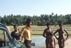 1977. Sri Lanka. A short brake between rice fields. Meeting two young men, who was just working in the rice fields Royalty Free Stock Image