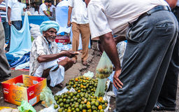 Sri Lanka street market. The old man sold the oranges in Sri Lanka Stock Image