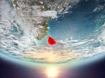 Sri Lanka with sun. Sri Lanka during sunrise highlighted in red on planet Earth with clouds. 3D illustration. Elements of this image furnished by NASA Royalty Free Stock Photos