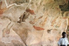 1977. Sri Lanka. Wall painting on Sigiriya rock. Famous wall frescoes, showing some beatiful semi-naked ladies, on the way to the top of the rock fortress Royalty Free Stock Images