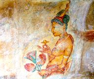 Old painted wall at Sigiriya. Sri Lanka is well known for its tea, but you can also visit temples rich in history like this one at Sigiriya built during 6th Stock Image