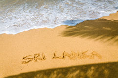 Sri Lanka written in a sandy on  tropical beach Royalty Free Stock Photo