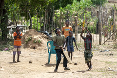 Sri Lankan boys play cricket on a dusty pitch near the town of Arugam Bay on the east coast of Sri Lanka. Royalty Free Stock Photo