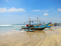 Sri Lankan fishing boats at the beach in Weligama Royalty Free Stock Image
