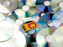 Sri Lankan flag on top of CD and DVD pile isolated on white Royalty Free Stock Photos