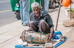 Sri Lankan old poor musician on the street Stock Photo