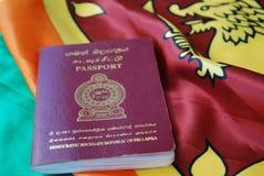 Sri Lankan Passport on Flag Stock Image