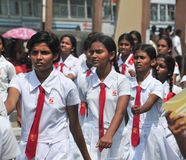Sri Lankan school children marching in Hikkaduwa Royalty Free Stock Photography