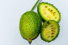 Sri Lankan spiny green bitter gourd green fruit vegetable on white background. royalty free stock photos