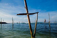 Sri Lankan traditional fisherman on stick in the Indian ocean Royalty Free Stock Image