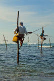Sri Lankan traditional fisherman on stick in the Indian ocean Royalty Free Stock Photos