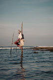 Sri Lankan traditional fisherman on stick in the Indian ocean Stock Photo