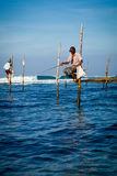 Sri Lankan traditional fisherman on stick in the Indian ocean Royalty Free Stock Photo