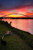 Sri Saujana Bridge during sunset and the photographer. Putrajaya Wetlands in Putrajaya, Malaysia is believed to be the largest constructed freshwater wetlands in Royalty Free Stock Photos