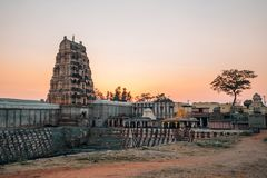 Sri Virupaksha temple with sunset in Hampi, India. Sri Virupaksha temple ancient architecture at sunset time in Ham stock photo