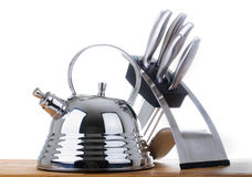 Série d'images des articles de cuisine. Théière et couteau Photographie stock