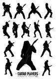 Série une de silhouette de joueurs de guitare Images stock