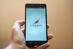 Srilankan airlines. Nitra, Slovakia, april 3, 2017: Man holding smartphone with Srilankan airlines application on the screen royalty free stock photos