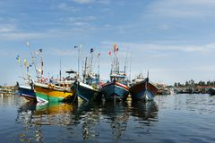Srilankan boat in harbour. Colourful srilankan boat in harbour ,with blue sky stock photo