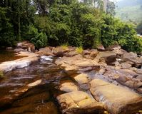 A srilankan river. A beautiful srilankan river with big rocks royalty free stock photo