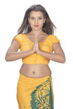 Srilankan women hand welcome. Asian teenager posse studio white background Royalty Free Stock Photos