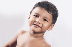 Srilankanen behandla som ett barn pojken Fotografering för Bildbyråer