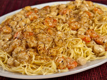 Srimp Scampi and Anglehair. Shrimp Scampi over a plate of Angle Hair pasta stock photography