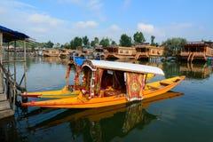 Landscape of Dal Lake in Srinagar, India. Srinagar, India - Jul 24, 2015. Traditional boats on Dal Lake at sunny day in Srinagar, India. Srinagar is the summer royalty free stock photos