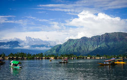 Landscape of Dal Lake in Srinagar, India. Srinagar, India - Jul 23, 2015. Wooden boats on Dal Lake in Srinagar, India. Srinagar is the largest city and the Royalty Free Stock Image