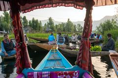 Unidentified vegetable sellers taking their produce to the floating market early in the morning on Dal Lake in Srinagar stock image