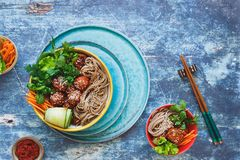 Sriracha meatballs with buckwheat soba noodles Royalty Free Stock Image