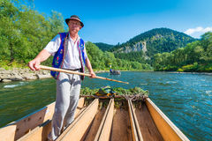 Sromowce Nizne, Poland - August 25, 2015. Dunajec River Gorge. Typical polish raftsman rafts tourists on the Dunajec river. The rafting near the Slovakian