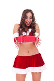 Srprised young santa woman with present Stock Photography