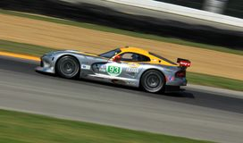 SRT Viper GTE-R. Tommy Kendall races the SRT Viper GTE-R at the professional motorsports racing event, International Motor Sports Association, Sports car club of Royalty Free Stock Images