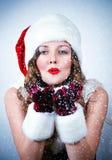 Srta. Santa que mira la nieve Fotos de archivo