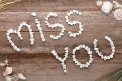 Srta. You Love Words Written en guijarros en la madera vieja Imagen de archivo